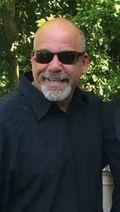 Jeff Chaponick sunglasses black shirt
